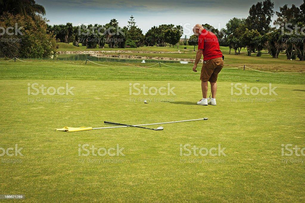Golfer on a green at a Golf course near Malaga.