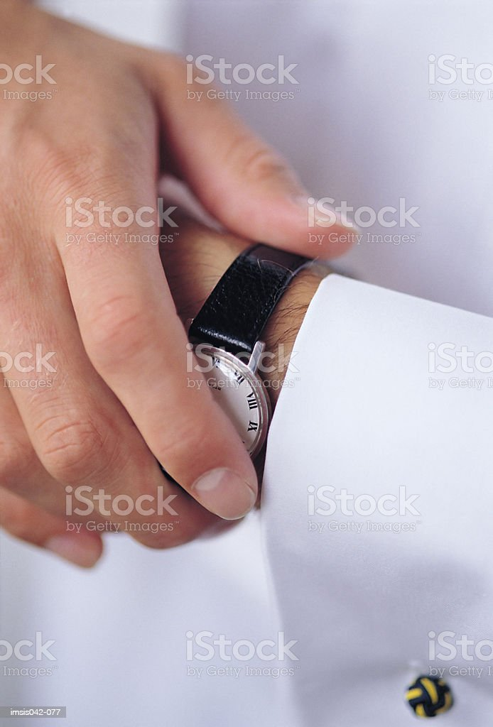 Putting on watch 免版稅 stock photo