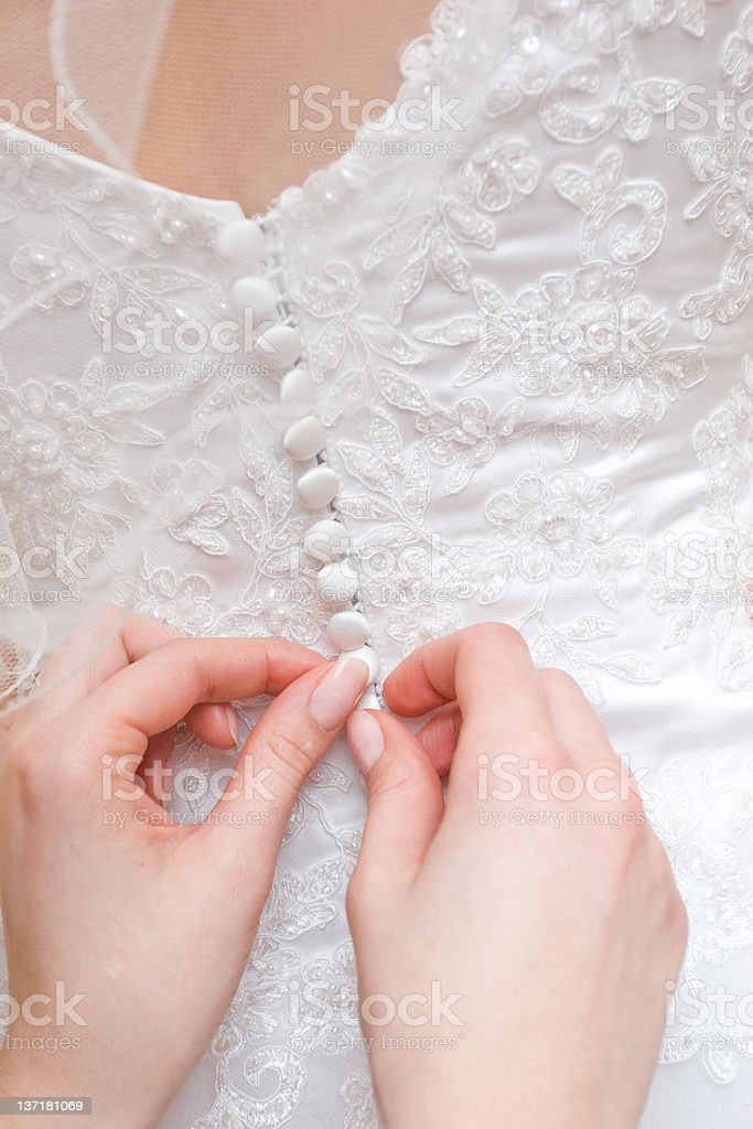 putting on wedding dress royalty-free stock photo