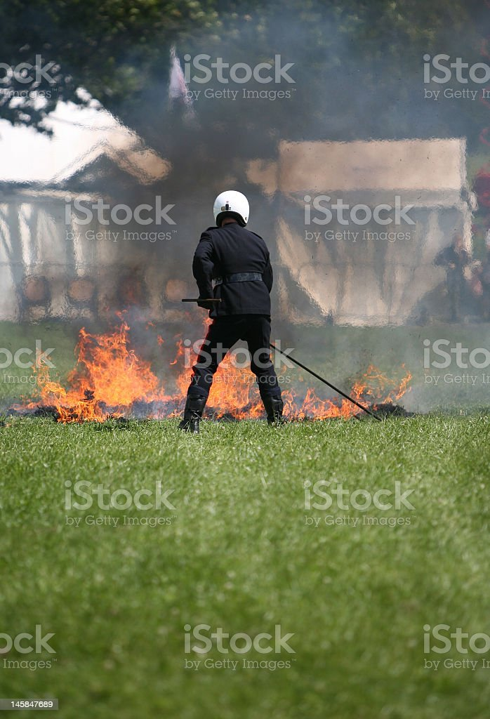 Putting out fire royalty-free stock photo
