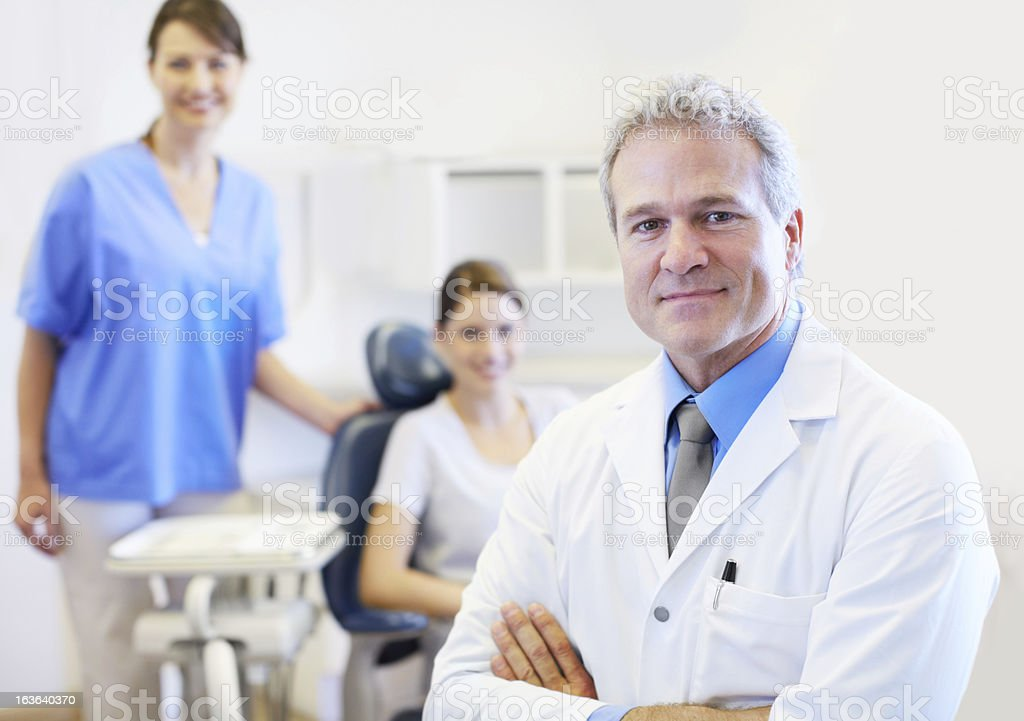Putting patients at ease with his friendly demeanour royalty-free stock photo