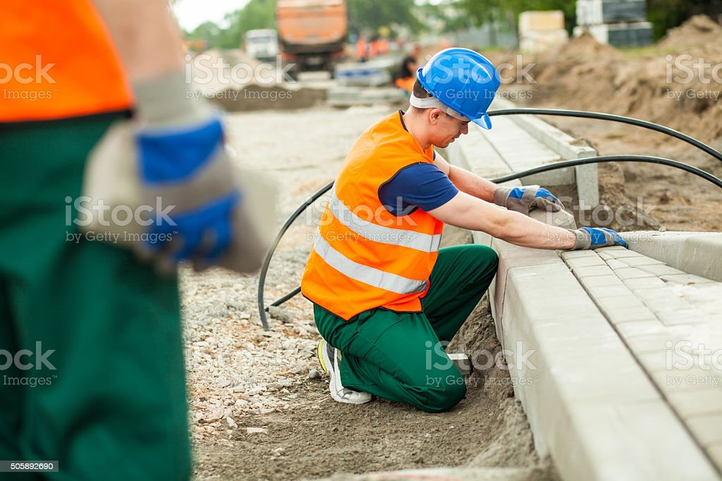 Putting paving stones stock photo