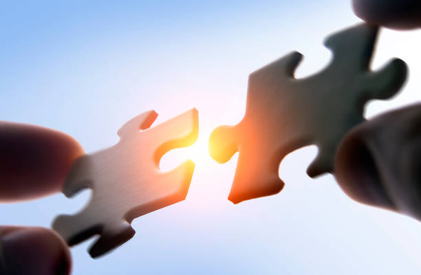 putting puzzle pieces together - changing form stock pictures, royalty-free photos & images