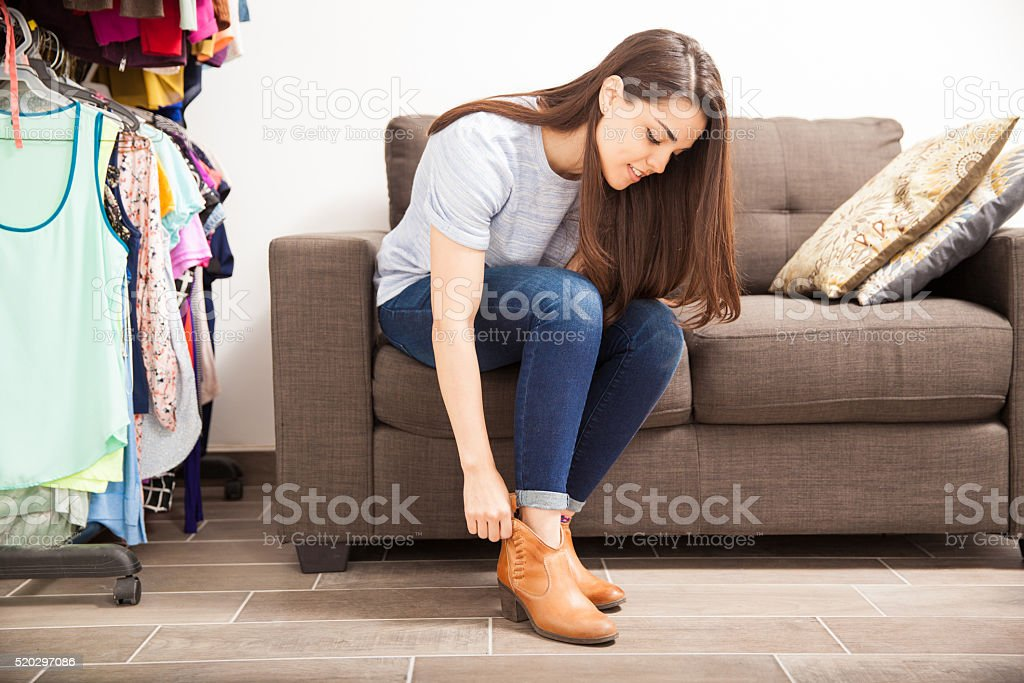 Putting shoes on in a dressing room stock photo