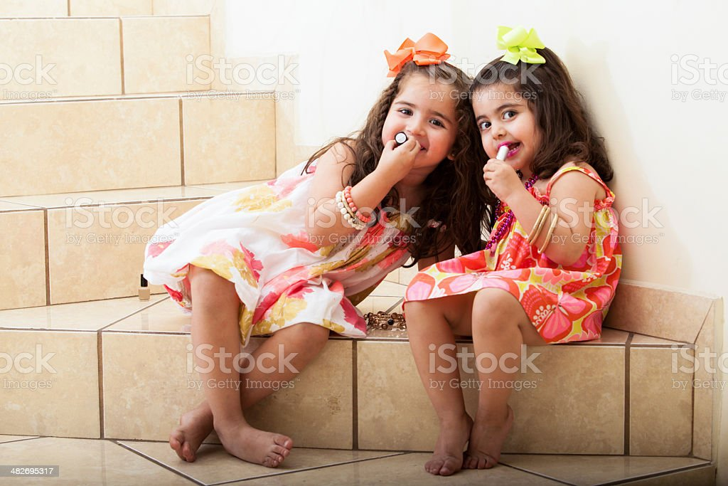 Putting some lipstick together stock photo