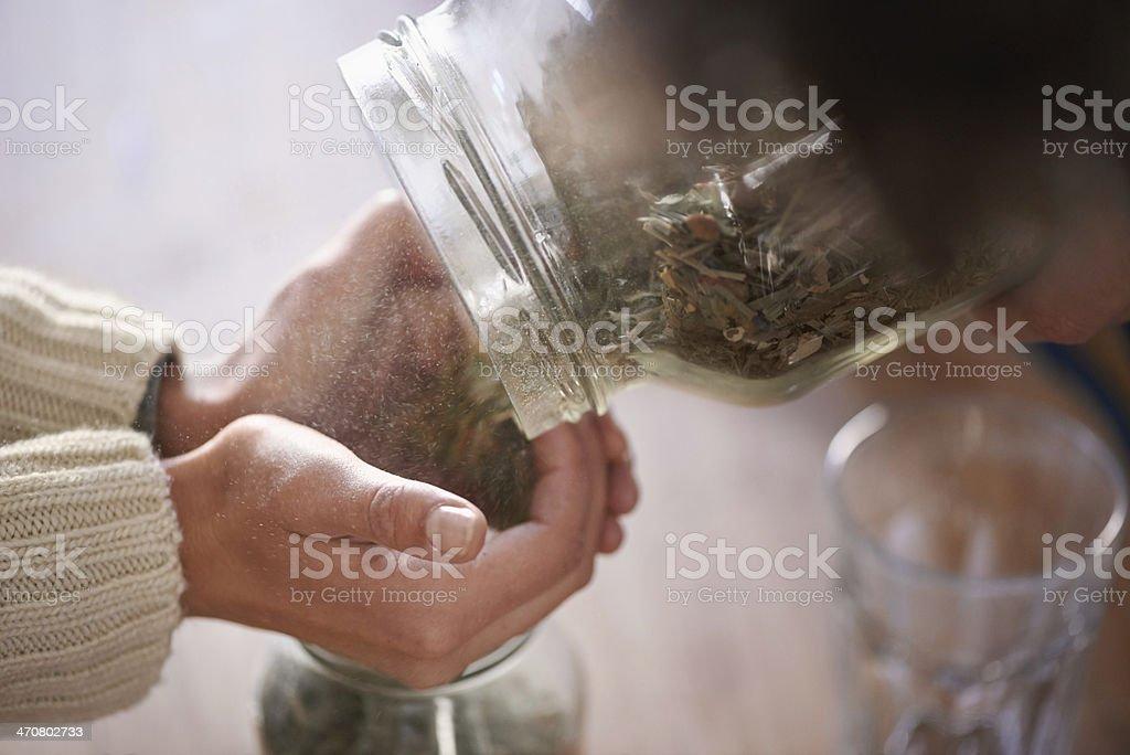 Putting tea leaves in jars stock photo