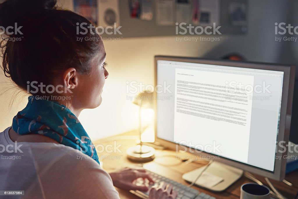 Putting the hours in at the office stock photo