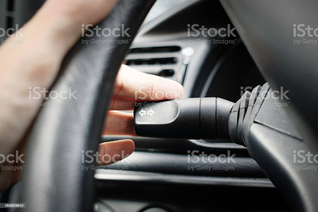 Putting the left blinker on stock photo