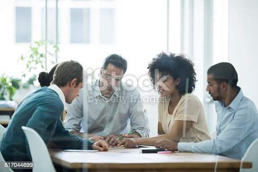 istock Putting their heads together 517044699
