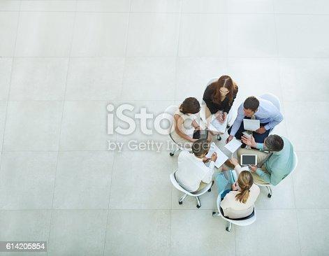 High angle shot of a group of businesspeople meeting in the office