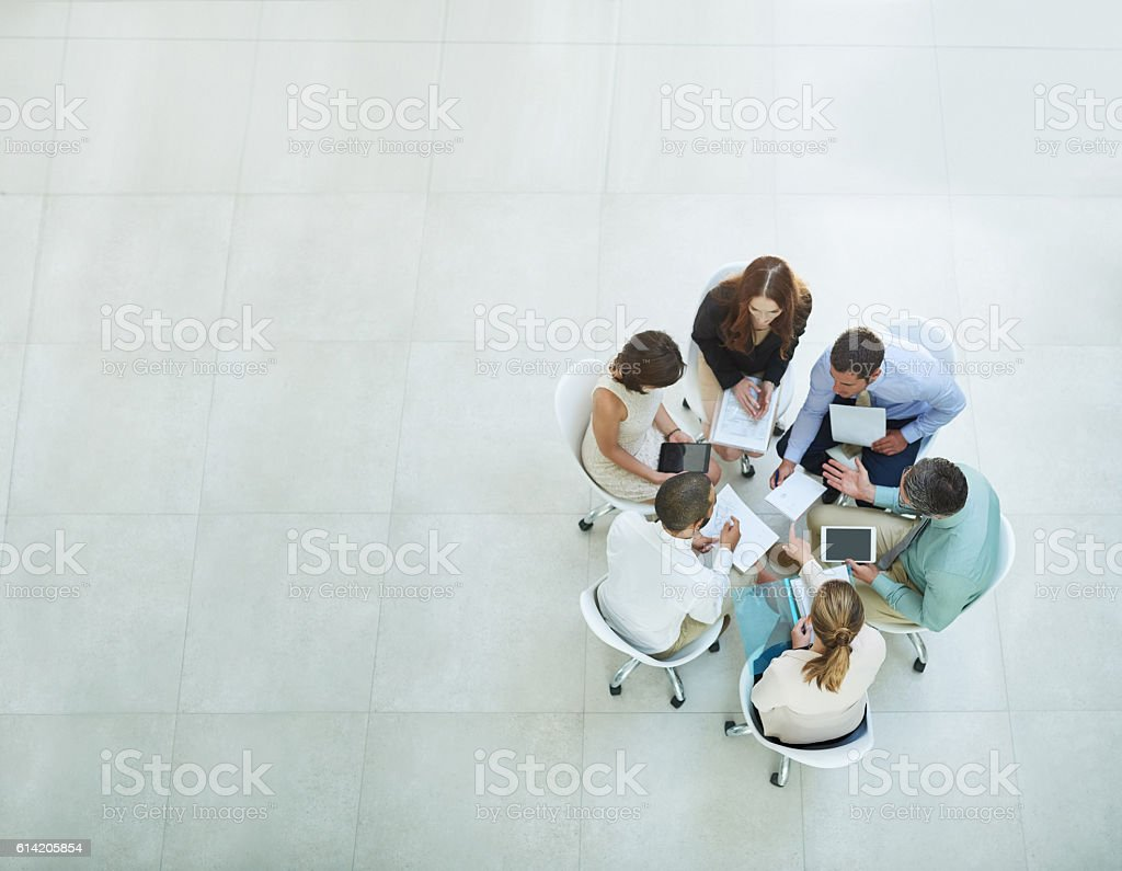 Putting their heads together stock photo