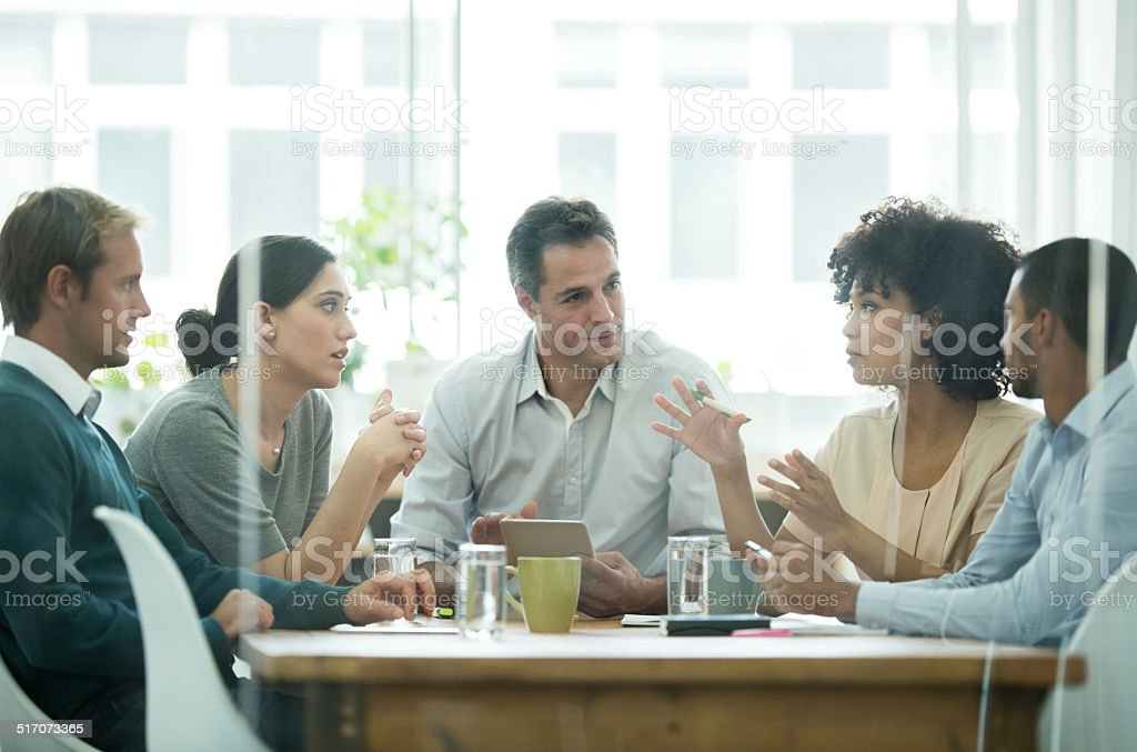 Putting their ideas on the table stock photo