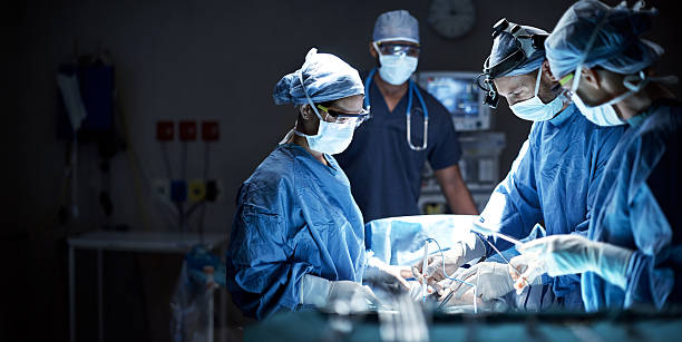 Putting their skills to good use Shot of a team of surgeons performing a surgery in an operating room anesthetize stock pictures, royalty-free photos & images