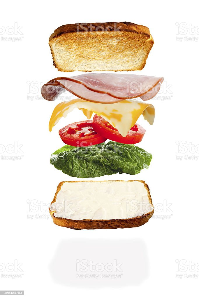 Putting Together a Cheese and Ham Sandwich stock photo