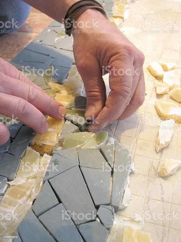 Putting together a mosaic royalty-free stock photo