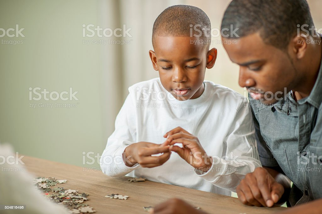 Putting Together a Puzzle stock photo