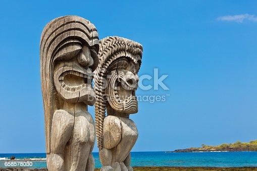 The recreated guardians statues at the Pu'uhonua o Honaunau National Historical Park on the Big Island of Hawaii. The