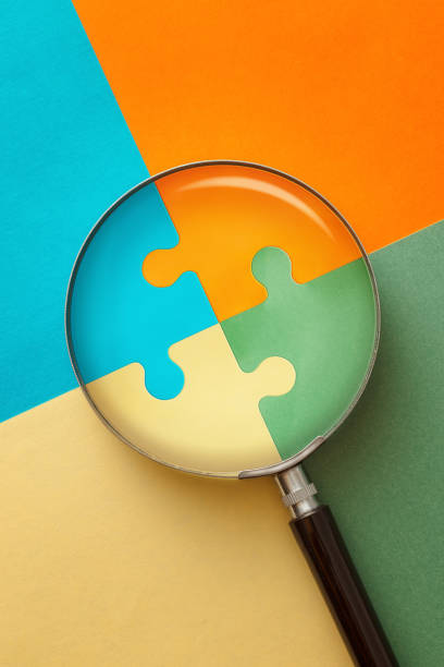 Puzzle and Magnifier stock photo