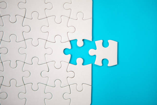 Puzzle Concept - White Jigsaw Puzzle Pieces On Blue Background Puzzle Concept - White Jigsaw Puzzle Pieces On Blue Background puzzle pieces stock pictures, royalty-free photos & images