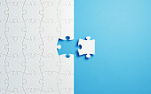 Puzzle Concept - White Jigsaw Puzzle Pieces On Blue Background