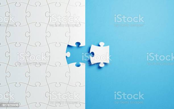 Puzzle concept white jigsaw puzzle pieces on blue background picture id927620036?b=1&k=6&m=927620036&s=612x612&h=8re0ub8d abpb5unxy2cluxrq3gom2fse3sq8xxw8xm=