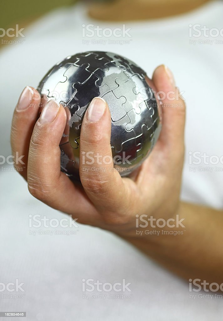 Puzzle globe in hand royalty-free stock photo
