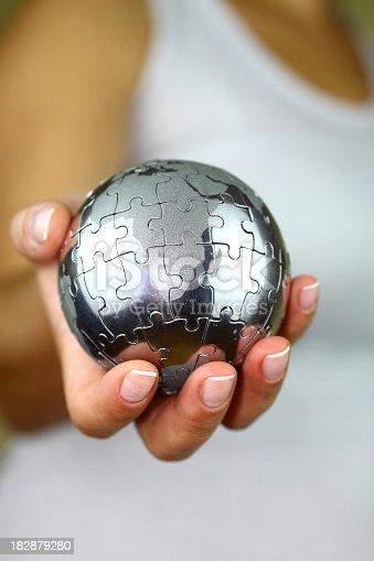 638813890istockphoto Puzzle globe in hand 182879280