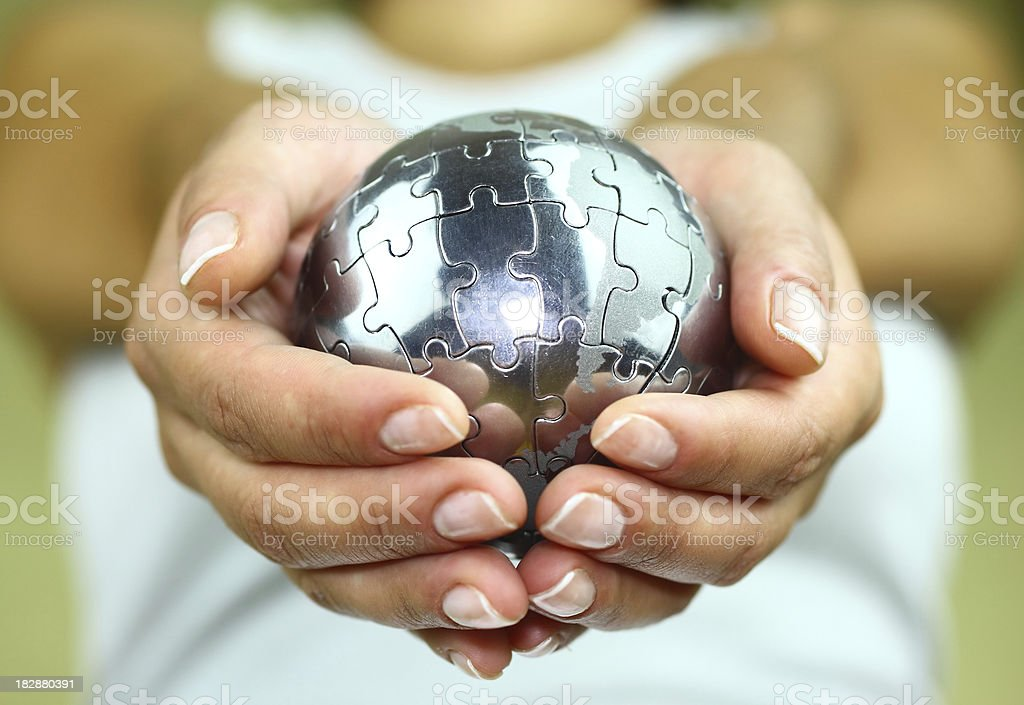Puzzle globe in palm stock photo