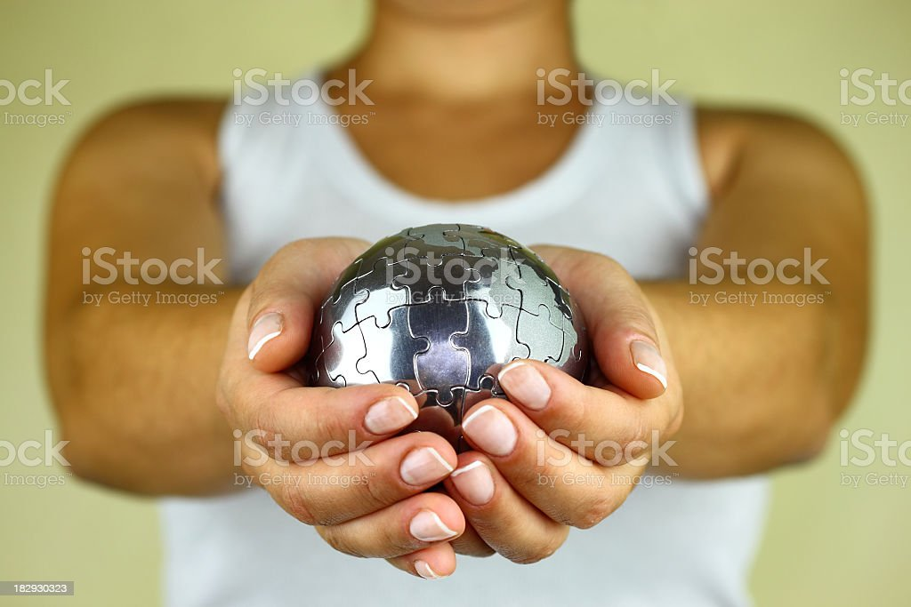 Puzzle globe in palm royalty-free stock photo
