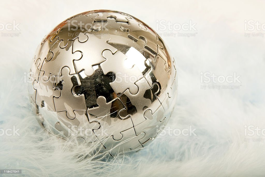 Puzzle Globe on feather royalty-free stock photo