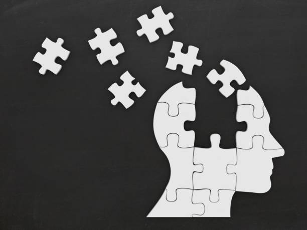 Puzzle head silhouette mind brain memory - foto stock