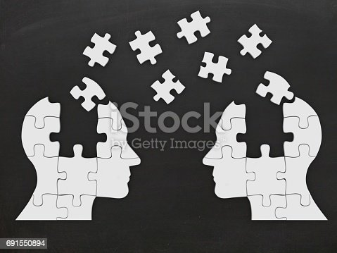istock Puzzle head silhouette open minded brain communication 691550894