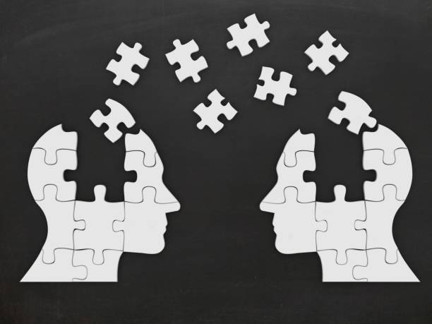 Puzzle head silhouette open minded brain communication stock photo