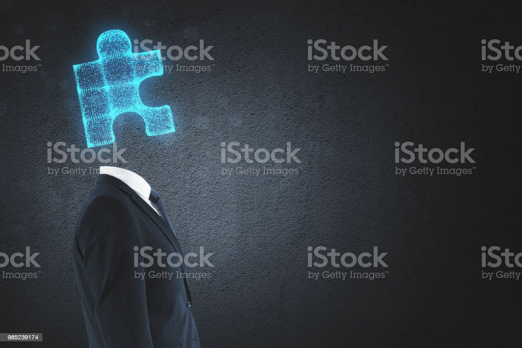Side view of puzzle headed man standing on abstract background with...