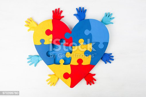 istock puzzle heart hands support autism awareness 970399760
