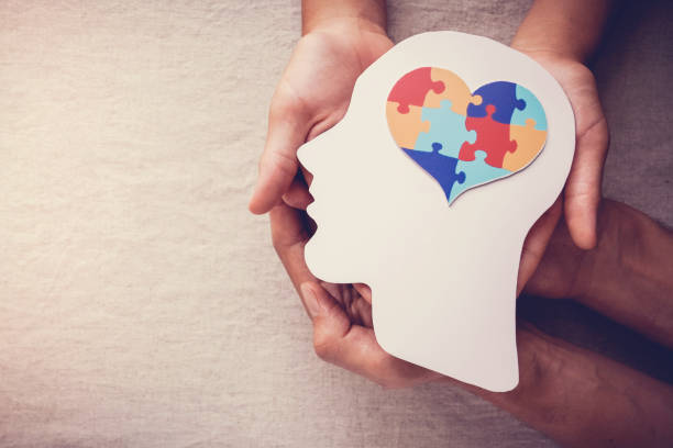 puzzle jigsaw heart on brain,  mental health concept, world autism awareness day puzzle jigsaw heart on brain,  mental health concept, world autism awareness day mental wellbeing stock pictures, royalty-free photos & images