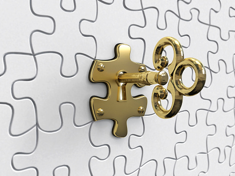 Gold key on the puzzle partSimilar images: