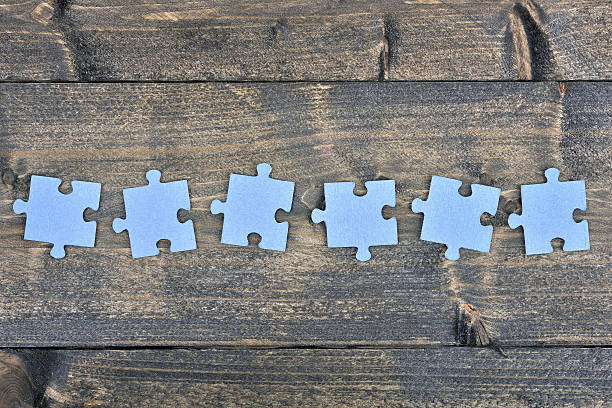 puzzle on wooden table - number 6 stock photos and pictures