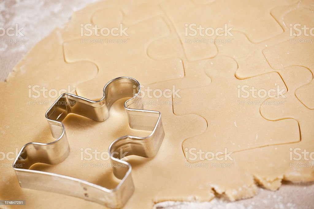 Puzzle Piece Cookie Cutter With Dough stock photo
