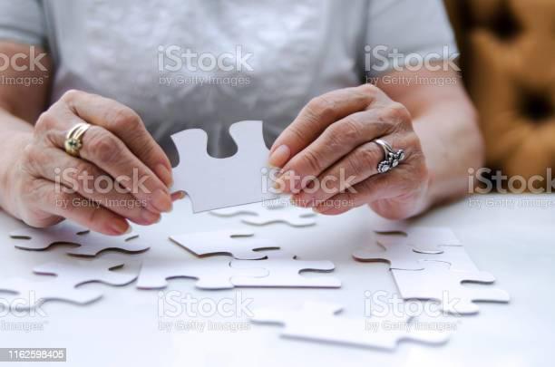 Puzzle piece in senior woman hands picture id1162598405?b=1&k=6&m=1162598405&s=612x612&h=bx6qdcgqalu rb1vajwrqsvzqngjjsvdjsf3zglknqo=