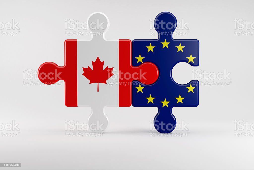 Puzzle pieces as Symbol for the Relationship between Canada and stock photo