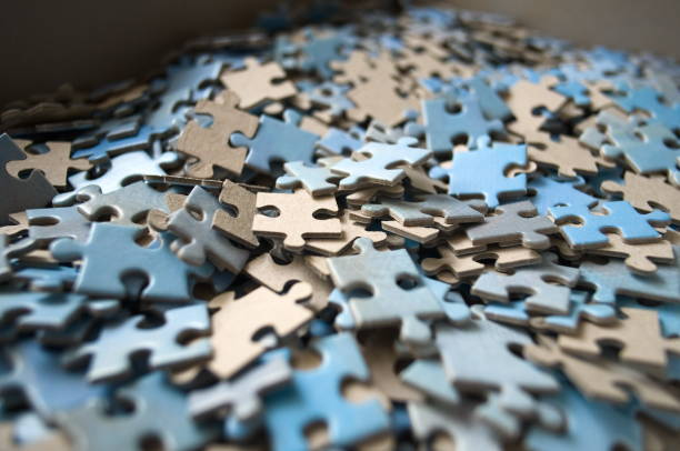 Puzzle pieces close up Puzzle pieces close up mostly blue color. Selective focus. jigsaw piece stock pictures, royalty-free photos & images