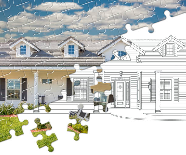Puzzle Pieces Fitting Together Revealing Finished House Build Over Drawing stock photo