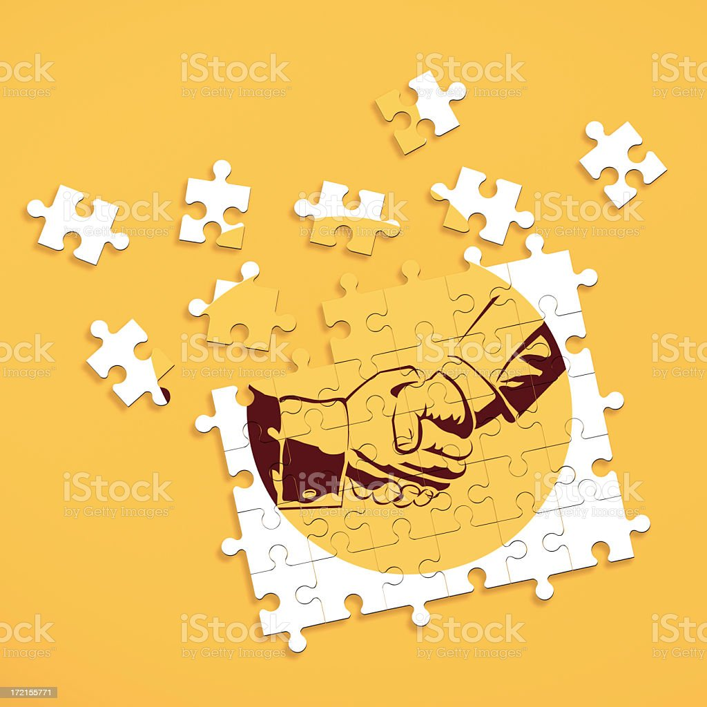 Puzzle pieces forming image of shaking hands stock photo