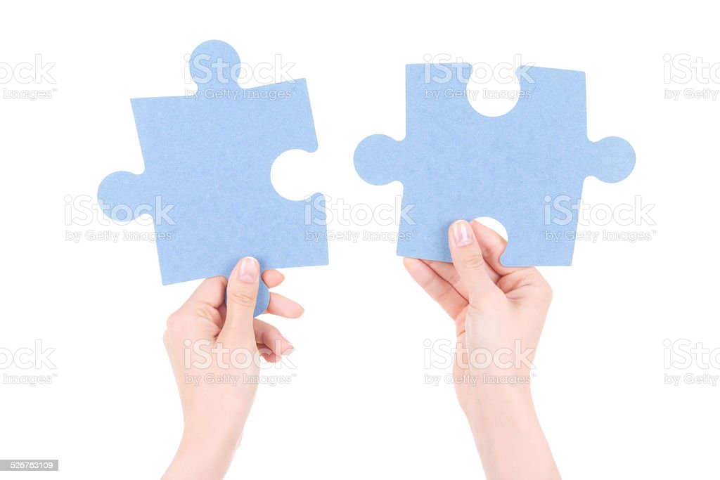 puzzle pieces in woman hands isolated on white stock photo