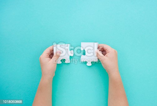 istock Puzzle pieces on blue background. Autism awareness day. 1018050868