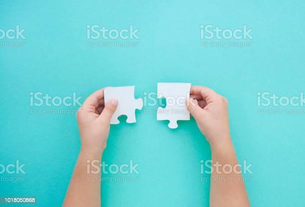 Puzzle pieces on blue background autism awareness day picture id1018050868?b=1&k=6&m=1018050868&s=612x612&h=pmzeklzbdurc bwqhqw8p4d go9ertjk4vrmzgxxmrs=