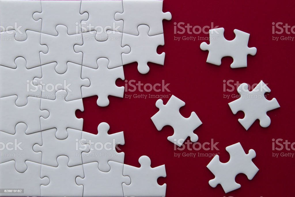 Puzzle pieces on red background. stock photo