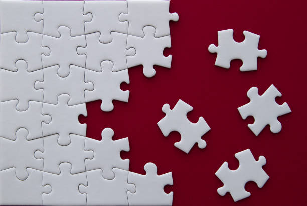 Puzzle pieces on red background. Puzzle pieces on red background. jigsaw piece stock pictures, royalty-free photos & images