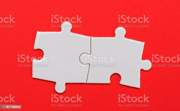 Puzzle pieces on red background two close up picture id1180768850?b=1&k=6&m=1180768850&s=612x612&h=y9pzieikhyvjh2xf mt3emjuj4llujg9ppdocd6a8d0=